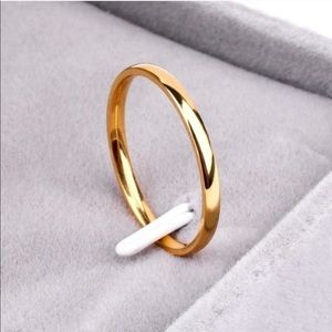 Jewelry - 2mm wide gold tone titanium band ring